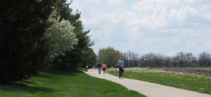 Cyclists and pedestrians use a multi-use path in Savoy.