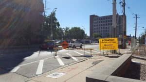 A closed sidewalk sign indicates construction as part of the MCORE project.