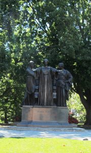 The Alma Mater statue, a large statue showing three figures in classical garb, a feature on the University of Illinois Urbana-Champaign campus.