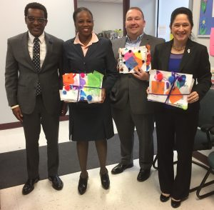 RPC CEO Dalitso Sulamoyo with Carol Ammons, Scott Bennett, and Susana Mendoza.
