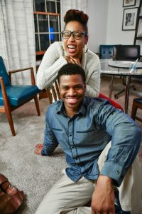 A young couple smiling and laughing