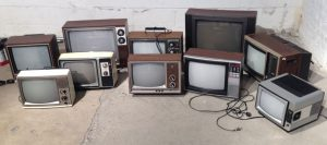 A collection of old televisions