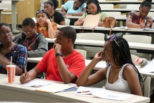 Students listen intently during a new hire orientation at Centennial High School