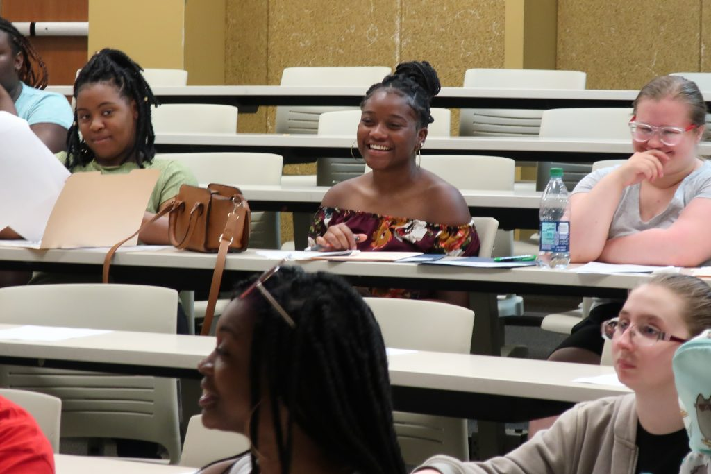 Students smile during a new hire orientation at Centennial High School