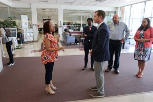 Workforce Development director Toriana Rhone welcomes Rodney Davis to the Illinois workNet Center.