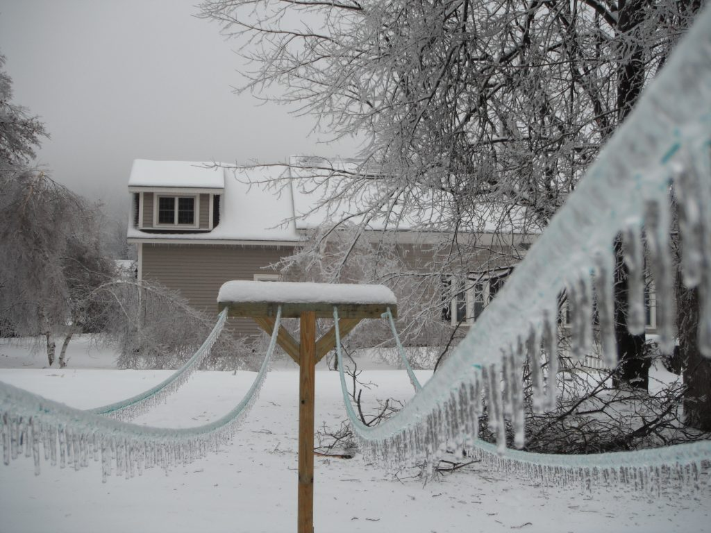An outdoor scene featuring snow and ice