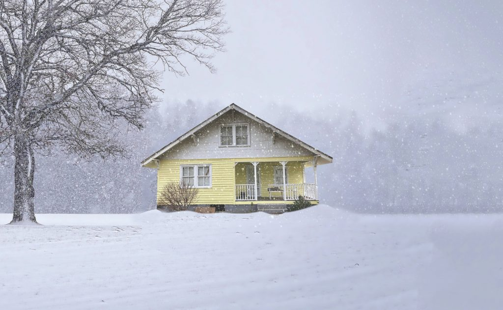 A small house in a wintry scene