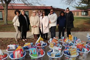 Members of the RPC's Early Childhood Education Program and agents from RE/MAX Realty Associates during the delivery of the baskets to the RPC's offices on November 20.