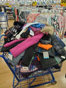 Some of the winter coats teacher Nichole Kitchens purchased for her classroom