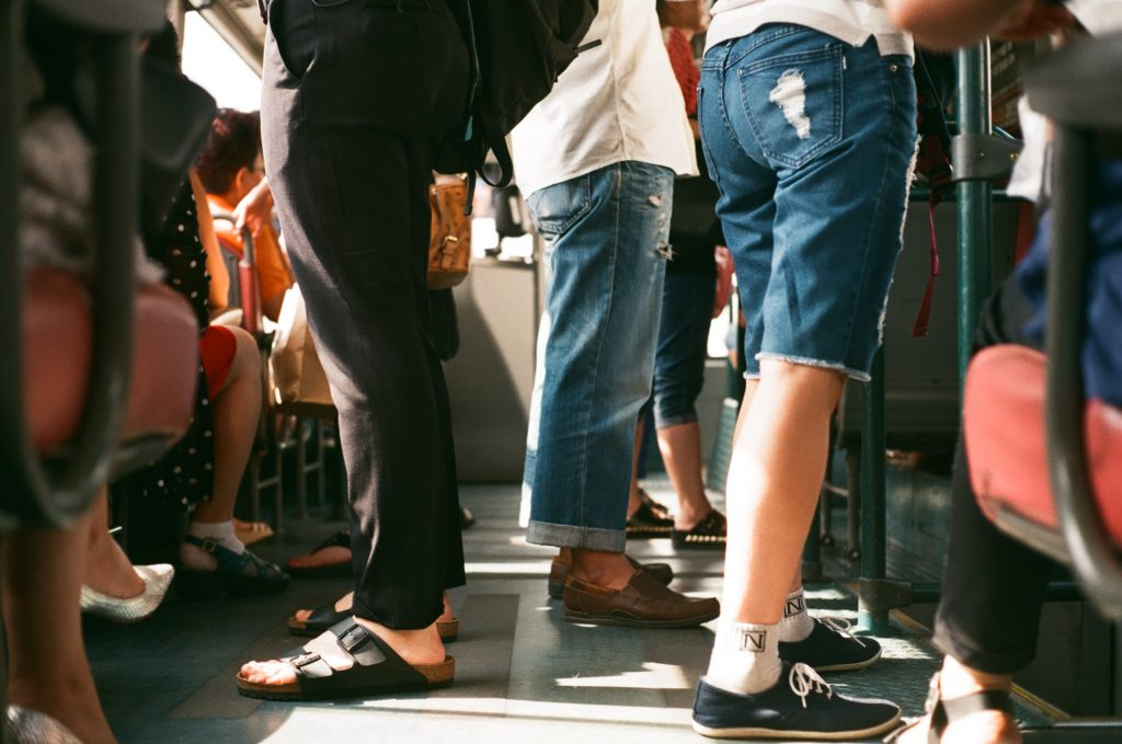 People standing on a crowded bus