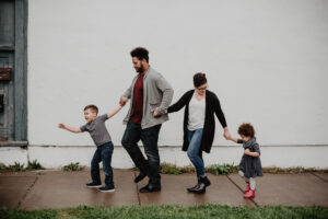 A family of four walking down the street