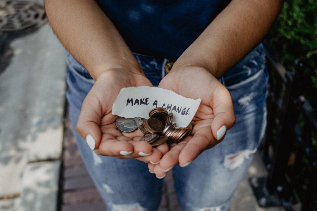 Hands holding an assortment of coins