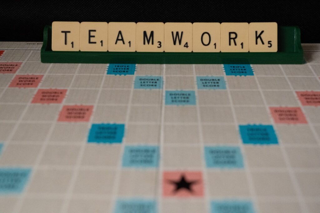 """A game board with the word """"teamwork"""" spelled out"""